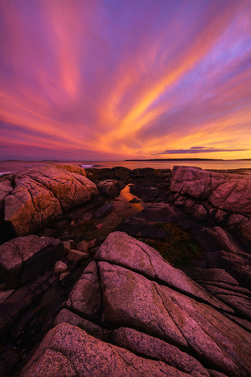 Dramatic sunset along the rocky coast of Maine in Acadia National Park.