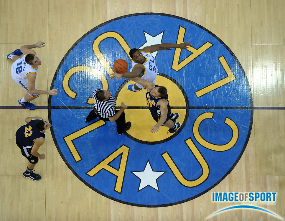 Dec 20, 2011; Los Angeles, CA, USA; General view of UCLA Bruins center Joshua Smith (34) and UC Irvine Anteaters center Adam Folker (20) at the opening tipoff at the Los Angeles Memorial Sports Arena.