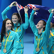 Swimming - Olympics: Day 1 The Australian team of Emma McKeon, Brittany Elmslie, Bronte Campbell and Cate Campbell, at the medal presentation for winning the gold medal in world record time in the Women's 4 x 100m Freestyle Relay Final during the swimming competition at the Olympic Aquatics Stadium August 6, 2016 in Rio de Janeiro, Brazil. (Photo by Tim Clayton/Corbis via Getty Images)