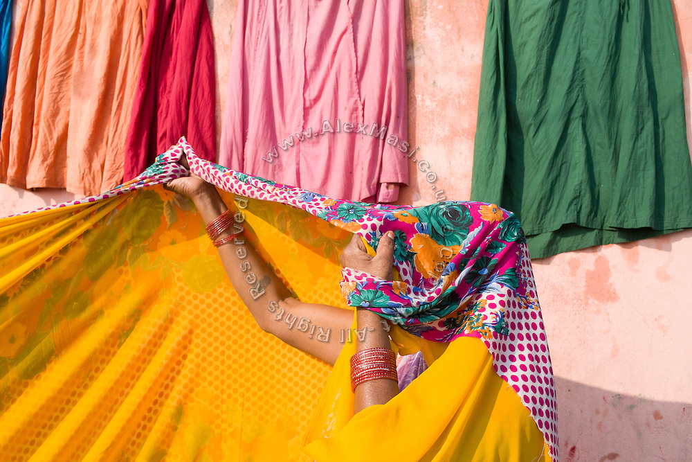 A Hindu devotee is drying her sari after having bathed in the holy Ganges River during the yearly Sonepur Mela, Asia's largest cattle market, in Bihar, India.