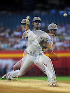 PHOENIX, AZ - MAY 27:  Pitcher Yu Darvish #11 of the Texas Rangers pitches against the Arizona Diamondbacks in the second inning of an interleagure game at Chase Field on May 27, 2013 in Phoenix, Arizona.  (Photo by Jennifer Stewart/Getty Images) *** Local Caption *** Yu Darvish