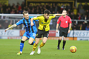 Burton Albion midfielder Scott Fraser (7) and Gillingham FC midfielder Mark Byrne (33) during the EFL Sky Bet League 1 match between Burton Albion and Gillingham at the Pirelli Stadium, Burton upon Trent, England on 12 January 2019.