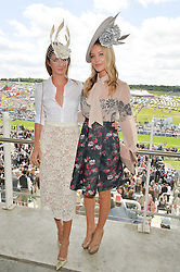 Left to right, MILLIE MACKINTOSH and LAURA WHITMORE at the Investec Derby 2015 at Epsom Racecourse, Epsom, Surrey on 6th June 2015.