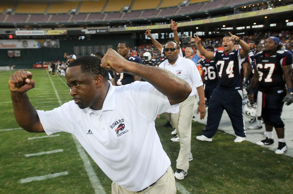 Washington DC--Howard University coach Gary Harrell raises his hands and runs onto the field as time runs out and his team wins the  AT&T Nation's Football Classic Saturday afternoon at RFK Stadium in Washington, DC . Howard University defeated Morehouse College 30-29.  (Photo by Alan Lessig)
