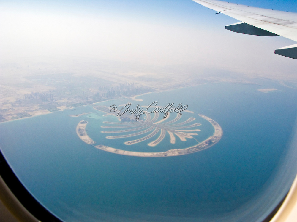Aerial view of Palm Jumeirah as seen from window seat of commercial airliner. An artificial, man-made, island off the coast of Dubai in the Persian Gulf, created for residential, hotel and entertainment use. Constructed by property developer Nakheel Properties, Dubai, UAE.