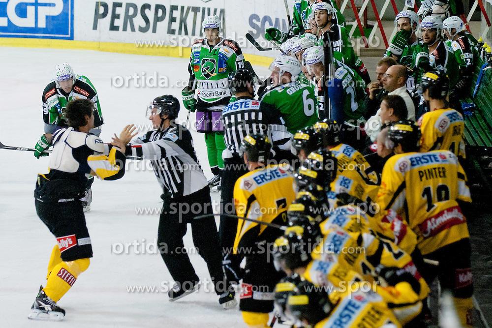 Fight between Bostjan Groznik (HDD Tilia Olimpija, #6) and Jonathan Ferland (UPC Vienna Capitals, #24) during of ice-hockey match between HDD Tilia Olimpija and UPC Vienna Capitals in 8th Round of EBEL league, on October 2, 2011 at Hala Tivoli, Ljubljana, Slovenia. (Photo By Matic Klansek Velej / Sportida)