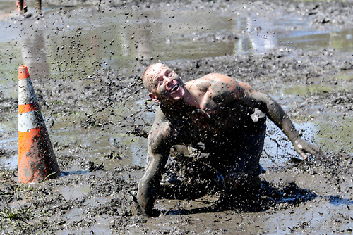 A player keeps his eye on the ball as he heads for 'mud lake' during MuddyGras, the 20th annual mud volleyball for Epilepsy at Wegerzyn Gardens MetroPark in Dayton, Saturday, July 10, 2010.