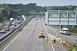 © Licensed to London News Pictures. 26/08/2017. Milton Keynes, UK. The road being cleaned up at The sceneon the M1 motorway near Milton Keynes after a crash involving a minibus and two lorries. Police say that several people are dead and four others have been taken to hospital after the accident on the southbound carriageway in the early hours of this morning. Photo credit: Ben Cawthra/LNP
