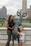 Deer sculpture on the Rich Street bridge, looking at downtown Columbus, Ohio.