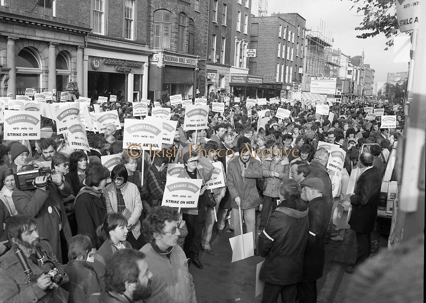 Irish Teachers Demonstration, Dublin.1985..06.11.1985..11.06.1985..6th November 1985..In an escalation of the dispute, teachers took their protest onto the streets of Dublin. This was the first in a series of work stoppages,all of the teachers unions were represented in the demonstration..A view down Dawson Street,Dublin of the teachers awaiting an address from the speakers on the podium