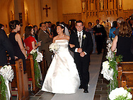 """Nicole Lee Pugliese and William Patrick Garvey stroll down the aisle after their wedding ceremony at St. Joseph's Church in Bronxville, NY on Friday, July 26, 2002. <br />Quote from Best Man, Patrick Dineen; """" Who would've thought that a New York Yankees fan (he) and a Boston Red Sox fan (she) would've gotten married..."""" (Photograph by Chet Gordon for the New York Daily News)"""