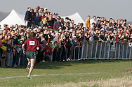 Warwick, N.Y. - Steve Murdock of Shenendehowa High School runs past a large crowd of spectators near the finish line on the way to winning the boys' Class AA race at the New York State Public High School Athletic Association cross country championships at Sanfordville Elementary School on Nov. 11, 2006.<br />