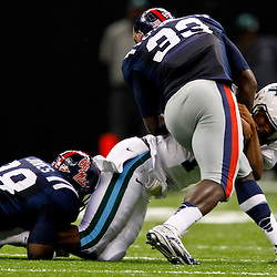 September 22, 2012; New Orleans, LA, USA; Ole Miss Rebels defensive end Jason Jones (38) and defensive end E.J. Epperson (33) combine to sack Tulane Green Wave quarterback Devin Powell (1) during the second quarter of a game at the Mercedes-Benz Superdome.  Mandatory Credit: Derick E. Hingle-US PRESSWIRE