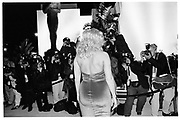 Anna Nicole Smith waving outside Mortons during Steve Tisch &  Vanity Fair's Oscar Night Party,<br /> Mortons,  Los Angeles. March 1994.  Film 94563/33<br />  <br /> © Copyright Photograph by Dafydd Jones<br /> 66 Stockwell Park Rd. London SW9 0DA<br /> Tel 0171 733 0108.