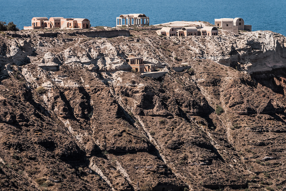 Incomplete houses litter the cliff side vistas of the island of Santorini in Greece, construction shuts down during the summer months, leaving immaculate building sites demonstrating amazing potential and stunning views of the Mediterranean