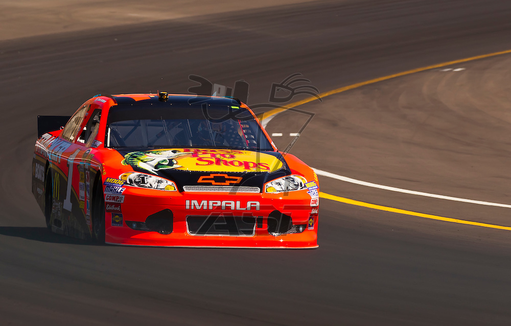 AVONDALE, AZ - MAR 03, 2012:  Jamie McMurray (1) brings his NASCAR Sprint Cup car through turn 4 during qualifying for the Subway Fresh Fit 500 race at the Phoenix International Raceway in Avondale, AZ.