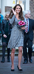 © London News Pictures. 19/02/2013. London, UK.  Catherine Duchess of Cambridge waving and carrying flowers as she leaves Hope House addiction centre for women in South London on February 19, 2013. The Duchess is due to meet clients and staff at Hope House, which is a 23-bed residential treatment centre for women with substance dependance. The Action Photo credit: Ben Cawthra/LNP