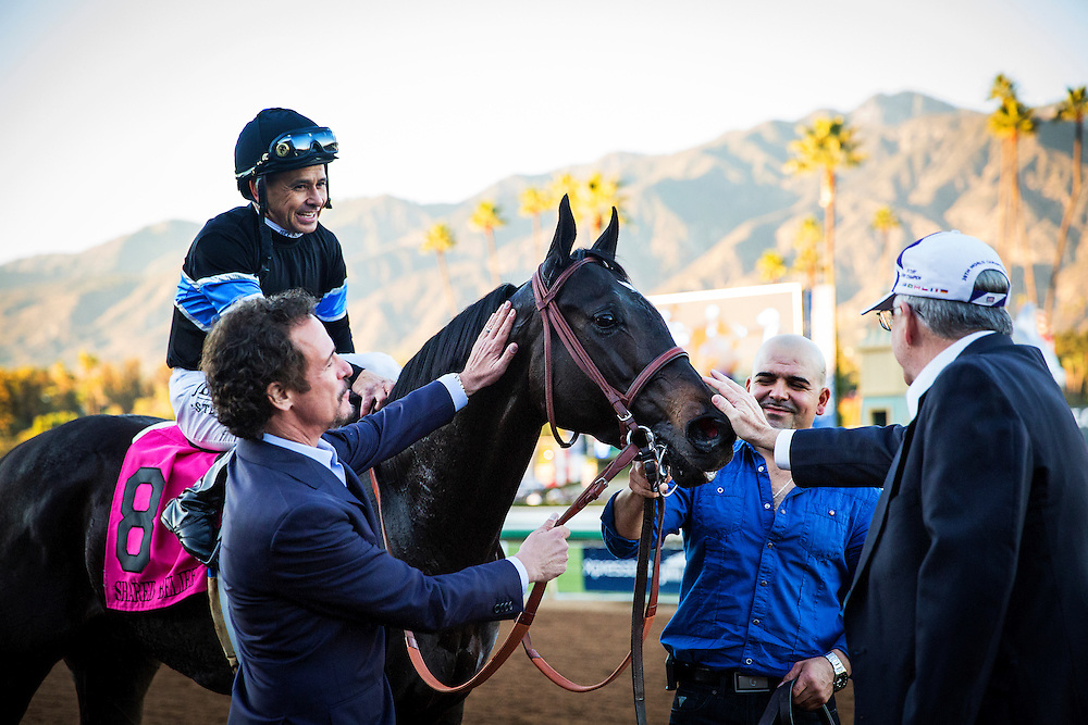 December 26 2014: Owner, Jim Rome shows his admiration for Shared Belief after winning the Malibu Stakes at Santa Anita Park in Arcadia CA. Alex Evers/ESW/CSM
