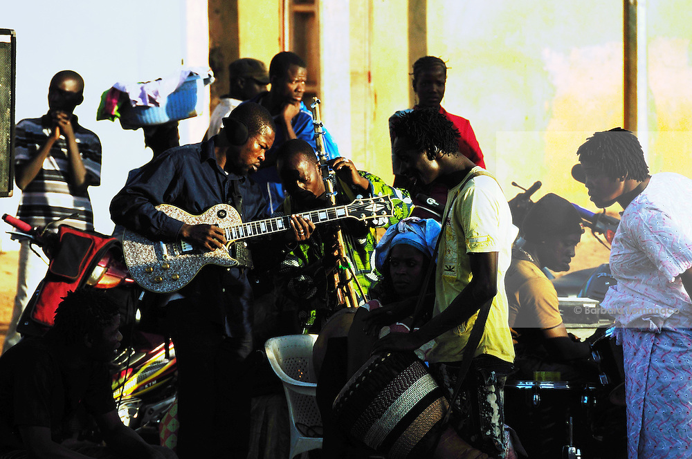 Musicians try their instuments during the 13th anniversary of the association for the defence of women's rights in Banakabougou, a Bamako district. 2011