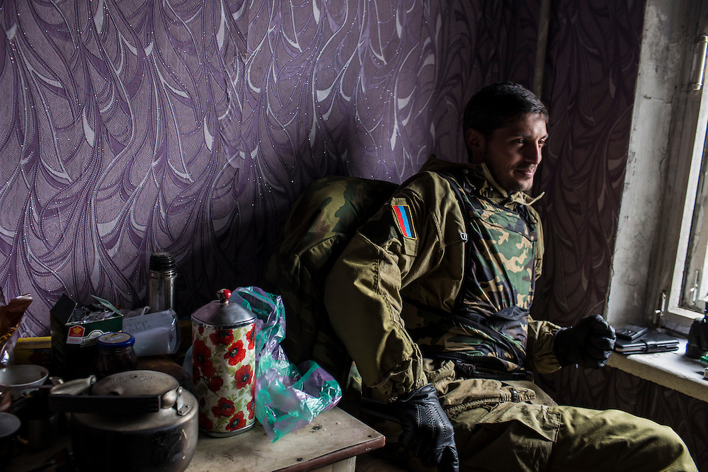 Pro-Russian rebel commander Mikhail Sergeevich Tolstikh, known as Givi, sits in an apartment building where his forces can observe and coordinate fighting to gain control of the Donetsk airport on Friday, October 17, 2014 in Donetsk, Ukraine. Photo by Brendan Hoffman, Freelance