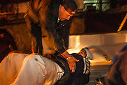 28 JANUARY 2005 - NOGALES, SONORA, MEXICO: A police officer in Nogales, Sonora, Mexico, arrests a suspected gang member in anti-drug sweep..  PHOTO BY JACK KURTZ