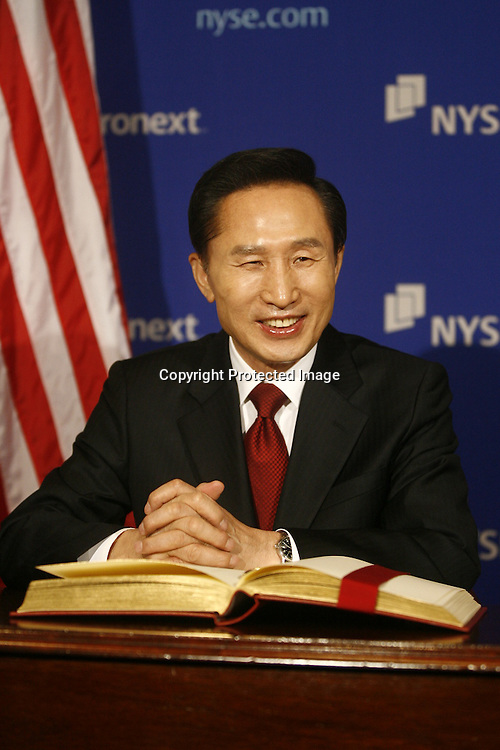 South Korea's President Lee Myung-bak smiles after signing the guest book of the New York Stock Exchange New York, April 16, 2008 REUTERS/Keith Bedford (UNITED STATES)