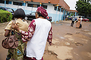 Counselor from UNICEF partner NGO Femme Active Cecile Traore, accompanies Marielle Gnabrayou Digbeto, 28, to the hospital pharmacy where she will get her eMTCT medication at the Koumassi general hospital in Abidjan Cote d'Ivoire on Friday July 19, 2013. Marielle is pregnant with her first child and HIV positive.