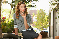 Pensive young woman in street