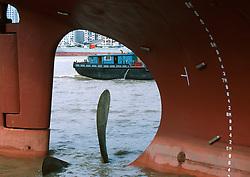 CHINA SHANGHAI NOV01 - View on the Huangphu river through the stern of a large ocean-going vessel.. . jre/Photo by Jiri Rezac. . © Jiri Rezac 2001. . Contact: +44 (0) 7050 110 417. Mobile:  +44 (0) 7801 337 683. Office:  +44 (0) 20 8968 9635. . Email:   jiri@jirirezac.com. Web:     www.jirirezac.com