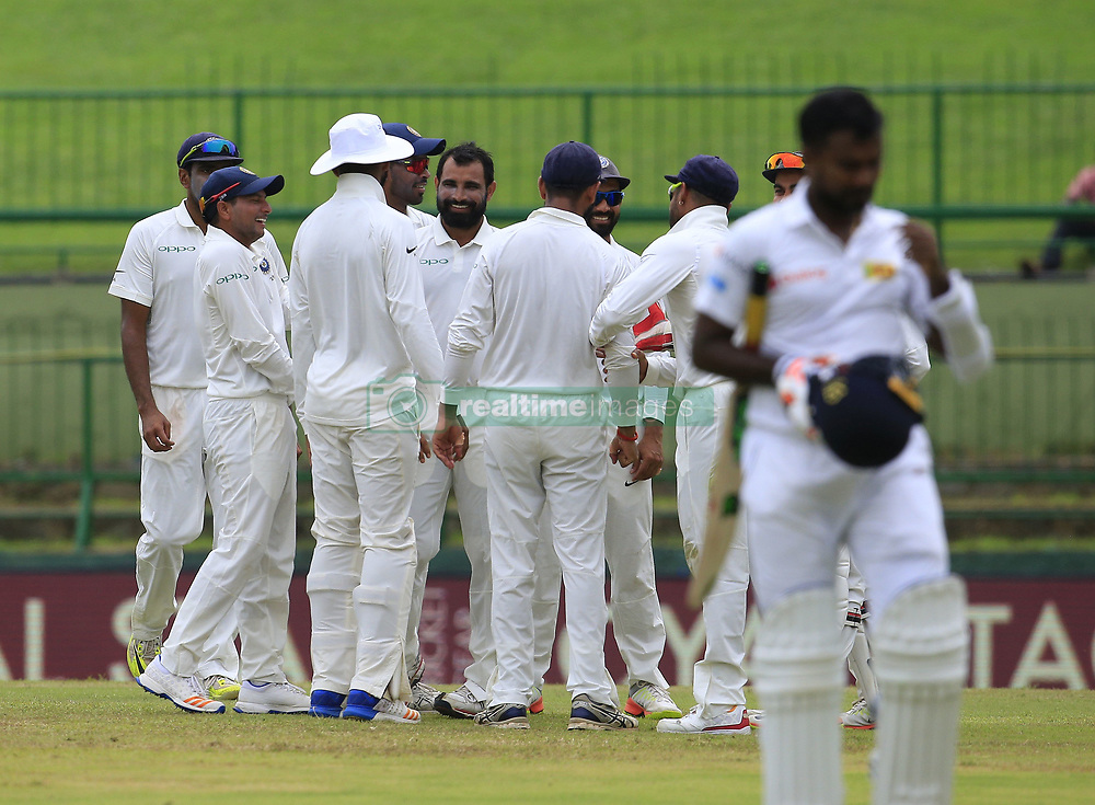 August 14, 2017 - Colombo, Sri Lanka - Indian cricketers celebrate the wicket of Sri Lanka's Malinda Pushpakumara during the 3rd Day's play in the 3rd and final Test match between Sri Lanka and India at the Pallekele international cricket stadium at Kandy, Sri Lanka on MOnday 14 August 2017. (Credit Image: © Tharaka Basnayaka/NurPhoto via ZUMA Press)