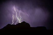 LIGHTNING OVER THE MESA AT OTOWI RUIN