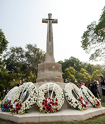 © Licensed to London News Pictures. 11/11/2012. Delhi, India. Wreaths lie beneath a memorial at a Remembrance Day ceremony held at the Delhi War Cemetery, India. Each wreath represents one of the armed forces from the various countries which took part in the world war.  Remembrance Day (also known as Poppy Day or Armistice Day) is a memorial day observed in Commonwealth countries since the end of World War I to remember the members of their armed forces who have died in the line of duty. This day, or alternative dates, are also recognized as special days for war remembrances in many non-Commonwealth countries. Remembrance Day is observed on 11 November to recall the end of hostilities of World War I on that date in 1918.   Photo credit : Richard Isaac/LNP