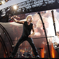 John Bon Jovi in concert with his band at Giants Statium.