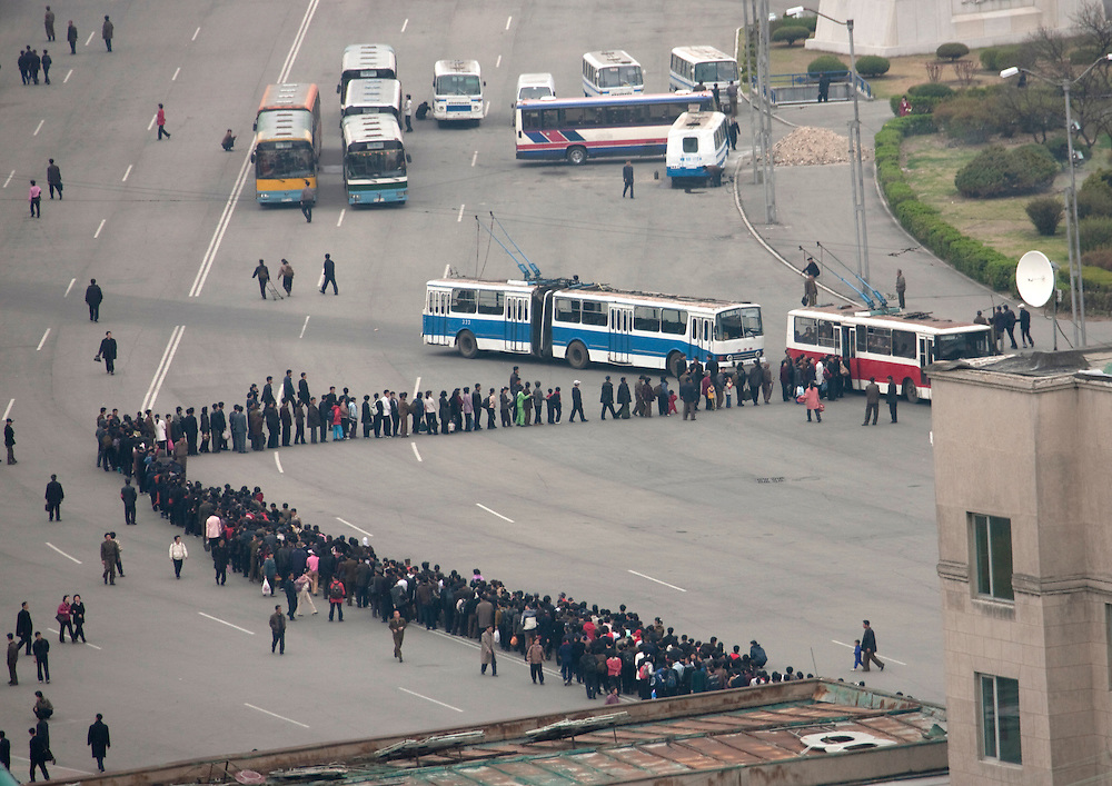 North Korea, Pyongyang, people queuing for bus. Queueing is a national sport for North Koreans.