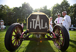 © Licensed to London News Pictures. 05/09/2013. London, UK. Classic automobile fans are seen with a 1907 Itala 120hp at the St James's Concours of Elegance classic car event at Royal Gardens of St James's Palace in London today (05/09/2013). The event, which alternates each year between Windsor Castle and St James's Palace, features sixty rare cars from across the world and takes place over the next three days. Photo credit: Matt Cetti-Roberts/LNP