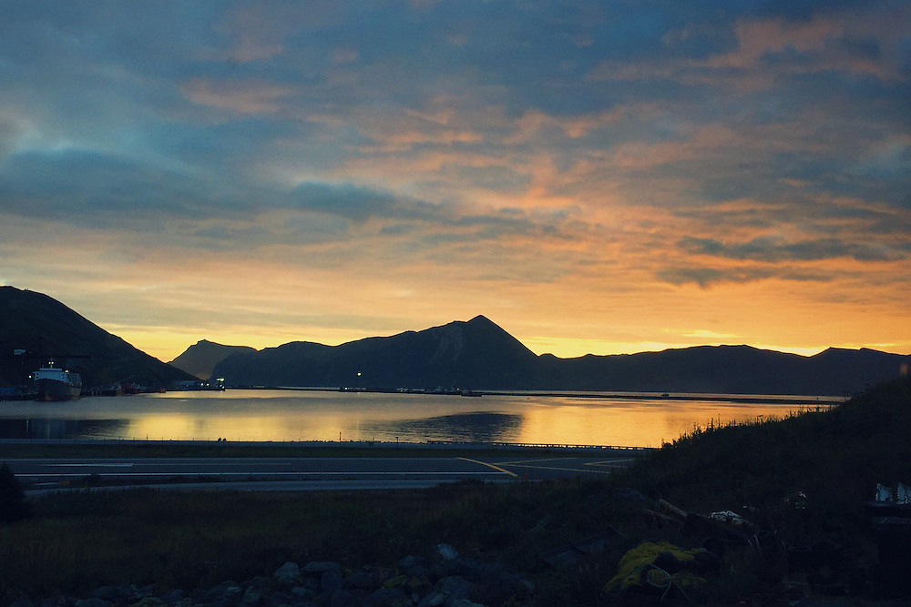 Sunrise over Iliuliuk Bay in Dutch Harbor, Alaska. Dutch Harbor is the primary port for fishing boats working in the Bering Sea. Taken with an iPhone