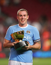 Richard Dunne celebrates with the Joan Gamper Trophy after the match between Barcelona and Manchester City at the Camp Nou Stadium on August 19, 2009 in Barcelona, Spain. Manchester City won the match 1-0.
