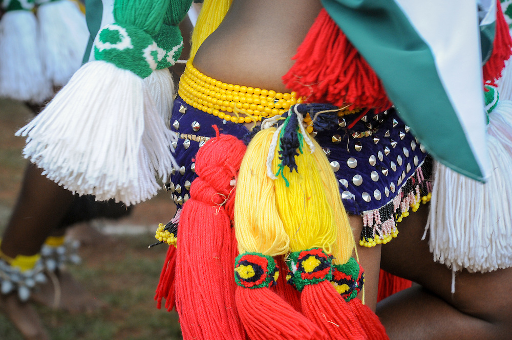 Ludzidzini, Swaziland, Africa - Annual Umhlanga, or reed dance ceremony, in which up to 100,000 young Swazi women gather to celebrate their virginity and honor the queen mother during the 8 day long event.<br /> Costume details