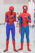 UNITED KINGDOM, London: 24 October 2015. <br /> Comic Con Feature.<br /> Cosplay fans dressed as Spider-Man stand lost at the MCM London Comic Con at the ExCel Arena in east London. <br /> Photo: Rick Findler / Story Picture Agency