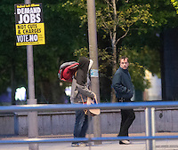John Clarke from Mayo and another protestor from the Occupy Galway protest heading off after being ejected from the protest village in Eyre Square Galway. Photo:Andrew Downes
