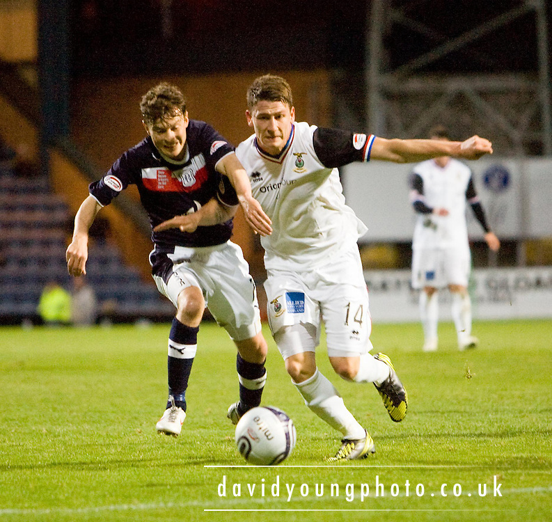 Inverness Caledonian Thistle's Josh Meekings  holds off Dundee's Nicky Riley - Dundee v Inverness Caledonian Thistle in the Clydesdale Bank Scottish Premier League at Dens Park - ©David Young