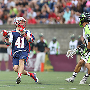 Mike Stone #41 of the Boston Cannons looks to throw the ball during the game at Harvard Stadium on July 19, 2014 in Boston, Massachusetts. (Photo by Elan Kawesch)