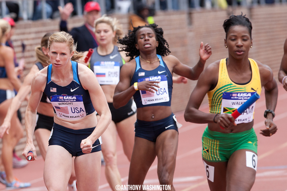Phoebe Wright with the USA Blue team, takes off after receiving the baton from teammate Barbara Pierre in the USA vs. the World Women Sprint Medley during the Penn Relays athletics meet Saturday, April 28, 2012 in Philadelphia, PA.