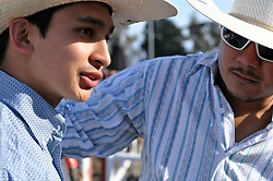 Riders talk in the long afternoon hours before the first round of Wednesday's 2013 PBR Touring Pro Division event at the Salinas Sports Complex.