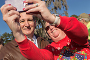 U.S. Senator and GOP presidential candidate Ted Cruz poses for a selfie with a support during a campaign event at Ottawa Farms December 19, 2015 in Bloomingdale, Georgia.