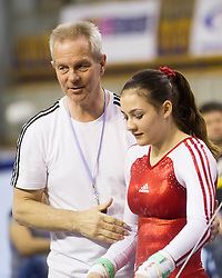 Elisa Haemmerle of Austria with her coach after she competed in the Uneven Bars during Final day 1 of Artistic Gymnastics World Cup Ljubljana, on April 27, 2013, in Hala Tivoli, Ljubljana, Slovenia. (Photo By Vid Ponikvar / Sportida.com)