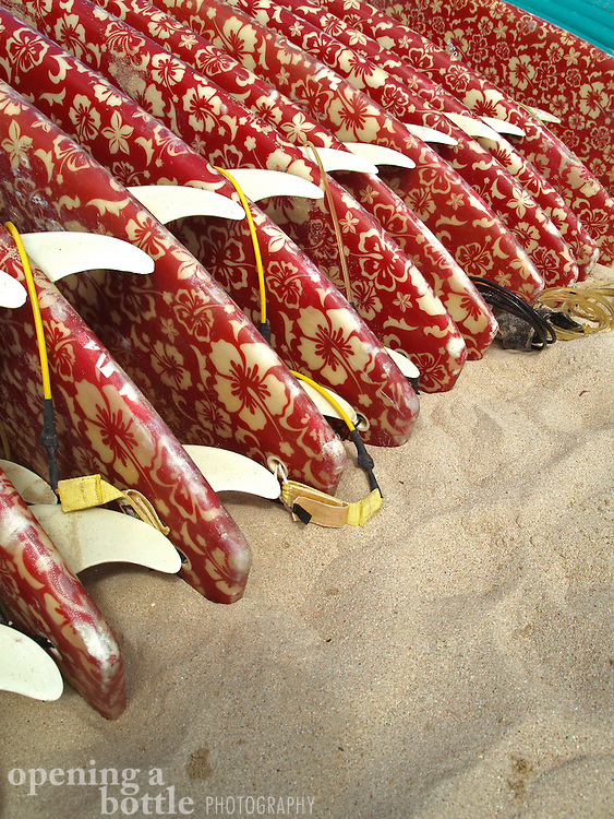 A row of surfboards lined up on Waikiki Beach, Honolulu, Hawaii.