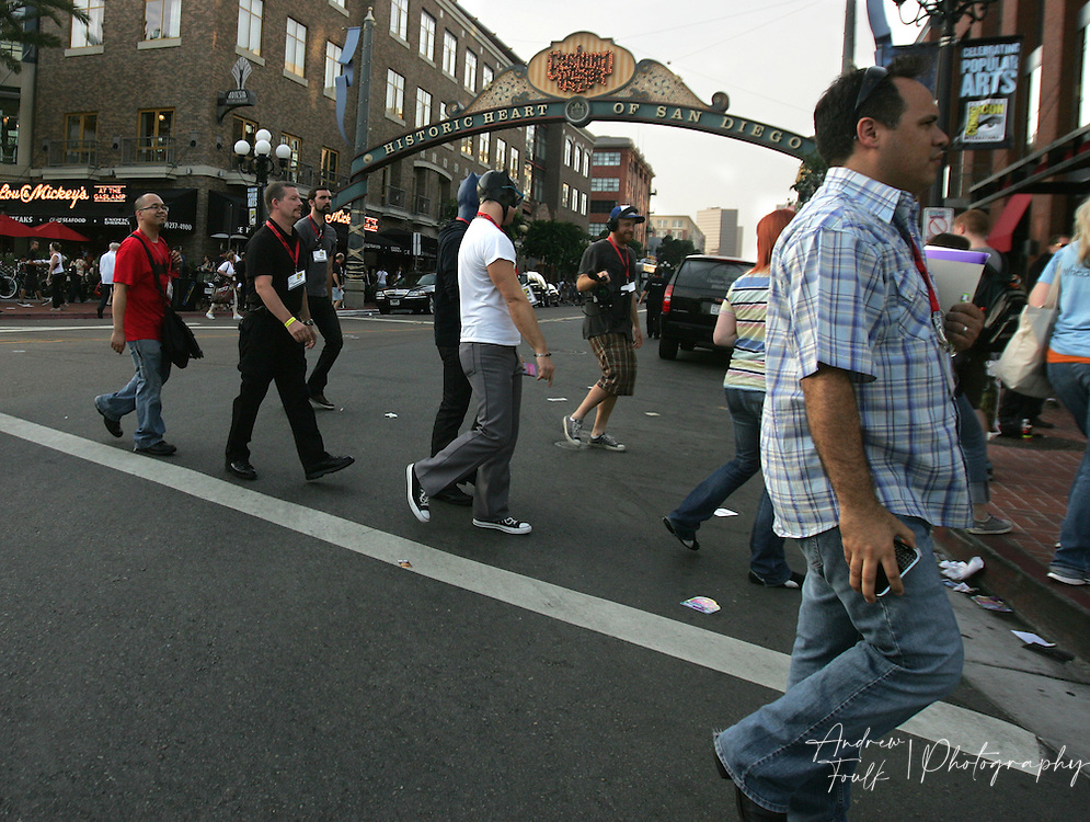 "Andrew Foulk/ Zuma Press.July 24, 2009, San Diego, California, USA. Comic Con. Comic Con attendees  cross into the "" Gaslamp Quarter"" of San Diego after leaving day two of the 40th annual San Diego International Comic Con."