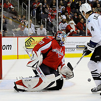 26 December 2007:  Washington Capitals goalie Olaf Kolzig (37) stops a shot off of his shoulder in the first period taken by Tampa Bay Lightning center Vincent Lecavalier (4) at the Verizon Center in Washington, D.C.  The Capitals defeated the Lightning 3-2.