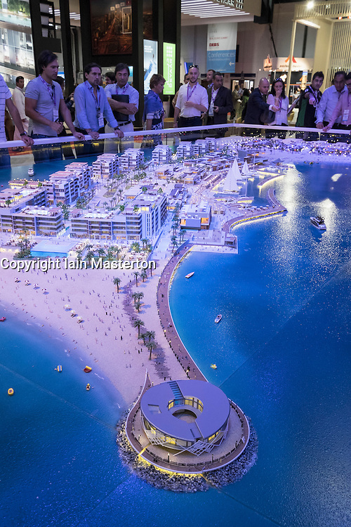 Model of new luxury property development La Mer in Dubai by developer Meraas at property trade fair in Dubai United Arab Emirates